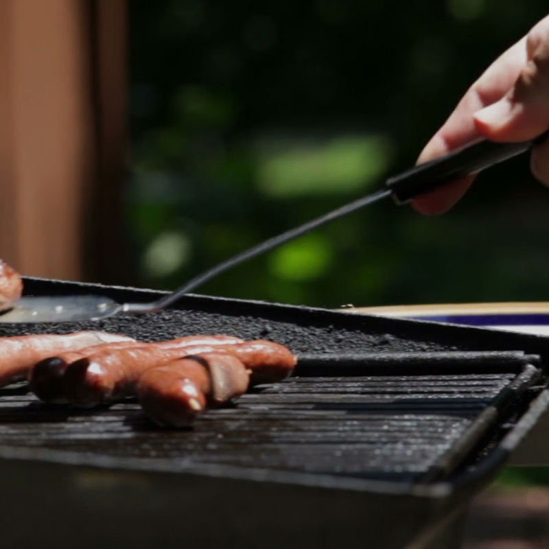 Person Grilling Outside
